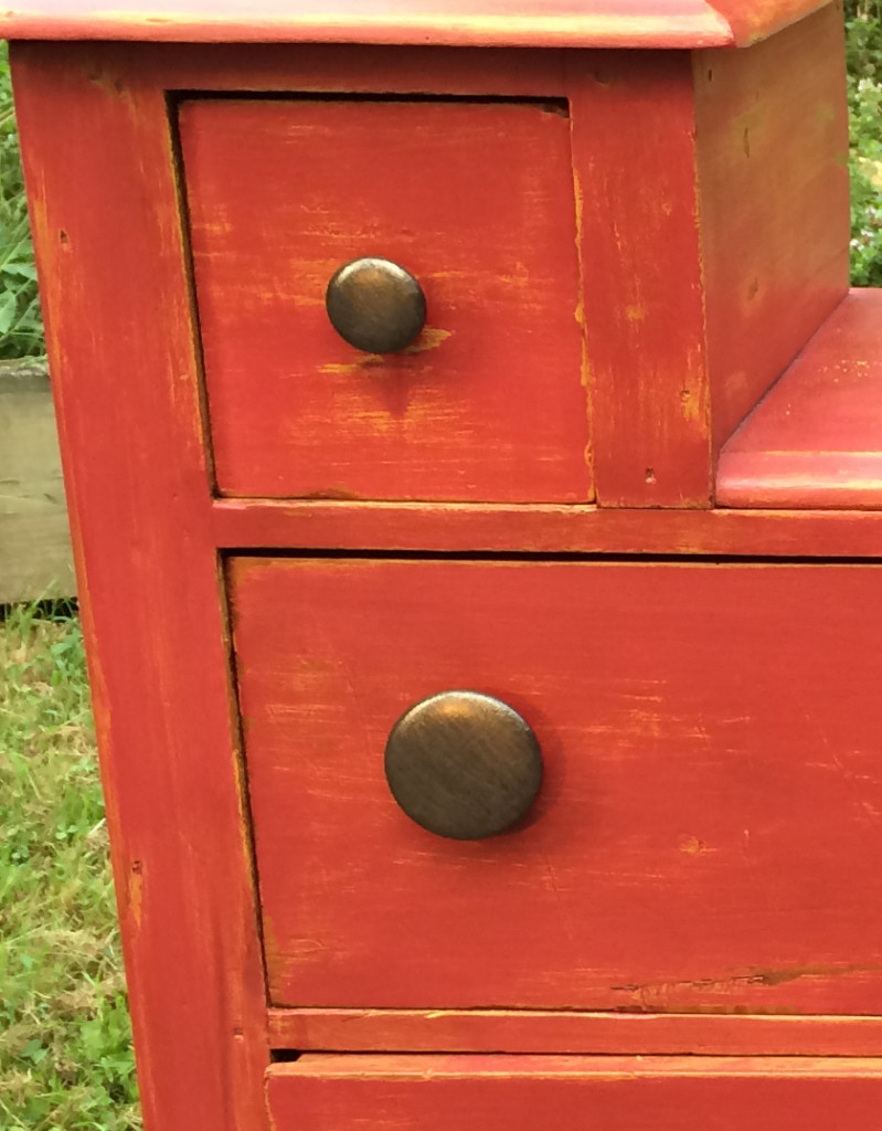Copper knobs and red paint